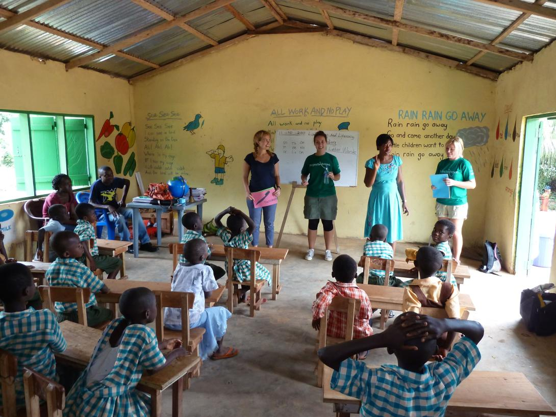 Volunteers teaching English in schools and supporting education, instead of volunteering in an orphanage.